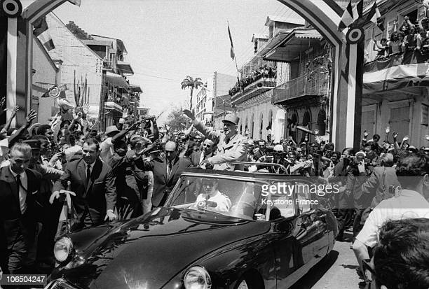 President Of The French Republic Charles De Gaulle And His Escort Walking Across The Street In PointeaPitre In Guadeloupe On March 22Nd 1964