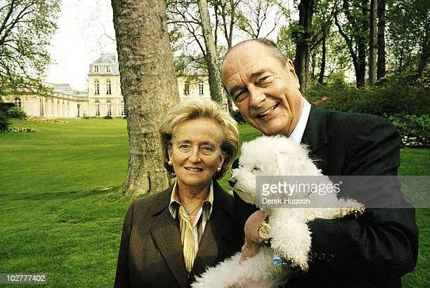 President of the French Republic Mr Jacques Chirac with his wife Bernadette pose for a portrait in the gardens of the presidential residence in the...