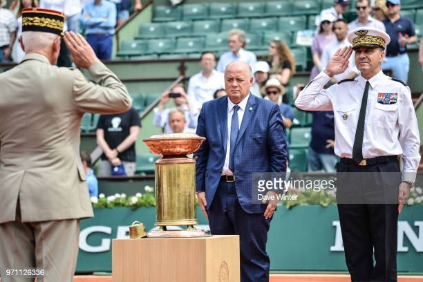 President of the French Tennis Federation Bernard Giudicelli in the presence of the chief of the French army and the chief air marshall supervises...