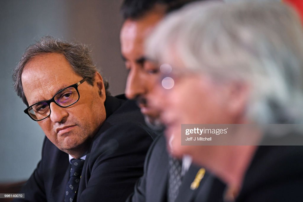 President of the Generalitat of Catalonia Quim Torra, lawyer Aamer Anwar and former Catalan Minister Professor Clara Ponsati attend a press conference ahead of a meeting with Scotland's First Minister Nicola Sturgeon on July 11, 2018 in Edinburgh, Scotland. Clara Ponsati is wanted by Spanish authorities to face charges relating to last year's Catalan independence bid. She faces up to 33 years in prison for charges including violent rebellion and misappropriation of public funds.