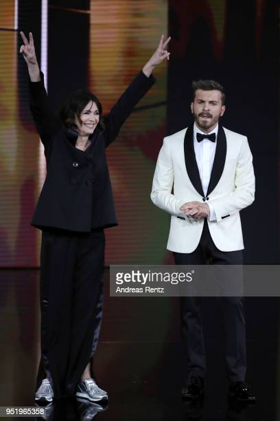 President of the German Film Academy Iris Berben and Host Edin Hasanovic perform on stage during the Lola German Film Award show at Messe Berlin on...