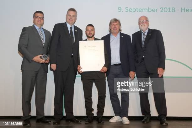 President of the German Football Association Reinhard Grindel and a member of National Association during the FairPlayMedal Awarding Ceremony on...