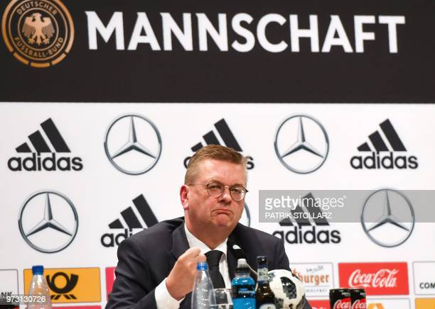President of the German Football Association Reinhard Grindel gestures as he speaks during a press conference in Vatutinki near Moscow on June 13...