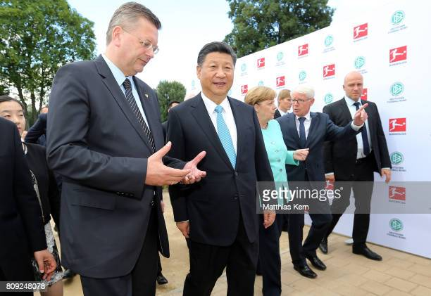 President of the German Football Association Reinhard Grindel Chinese President Xi Jinping German Chancellor Angela Merkel and the President of the...