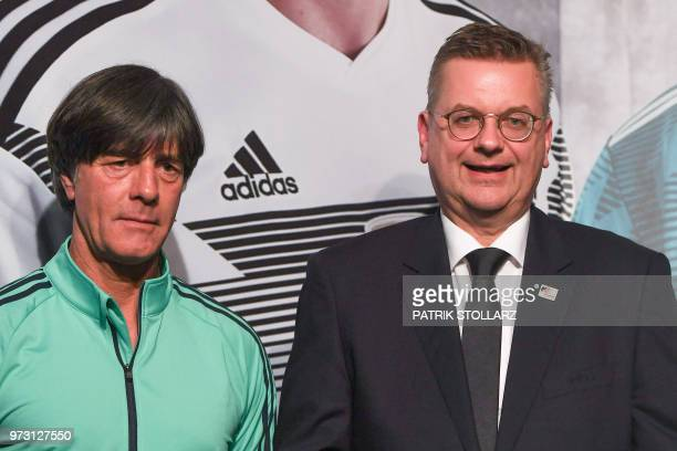 President of the German Football Association Reinhard Grindel flanked by Germany's coach Joachim Loew speaks during a press conference in Vatutinki...