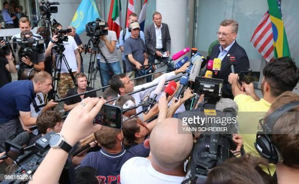 President of the German Football Association Reinhard Grindel talks to media as he arrives at Frankfurt international airport on June 28 after flying...
