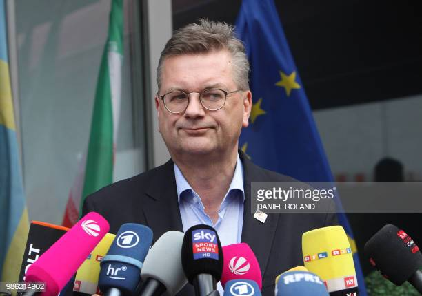 President of the German Football Association Reinhard Grindel talks to media as he arrives at Frankfurt international airport on June 28 after flying...