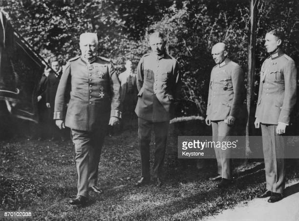 President of the German Reich Paul von Hindenburg watching German military manoeuvres at Bad Mergentheim Germany with his son and aidedecamp Oskar a...