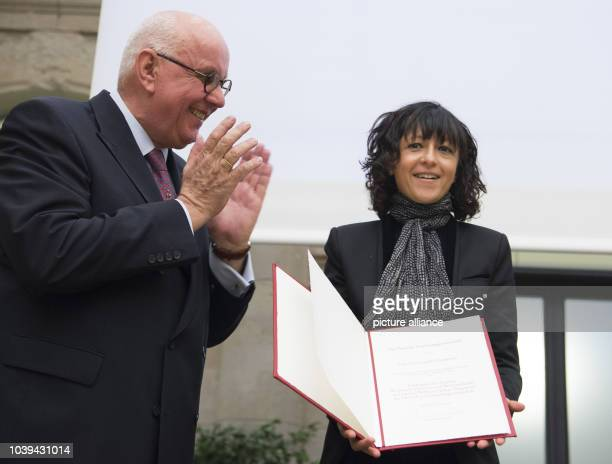 President of the German Research Foundation , Peter Strohschneider , presents an award to Emmanuelle Charpentier, of the Max-Planck-Institute for...