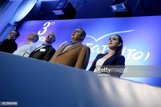 President of the government's junior coalition member Independent Greeks and Greek Defense Minister Panos Kammenos and party members chanting the...