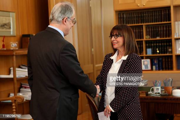 President of the Greek Parliament Konstantinos Tasoulas congratulates President of Council of State Katerina Sakellaropoulou after the result of a...