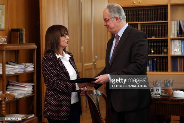 President of the Greek Parliament Konstantinos Tasoulas presents to President of Council of State Katerina Sakellaropoulou the result of a parliament...