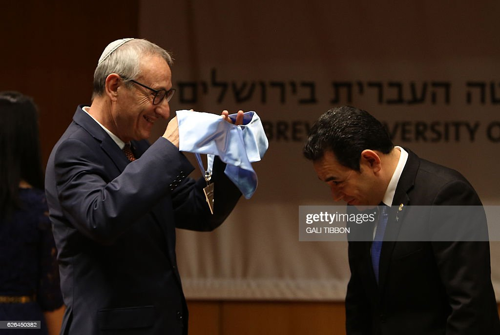 President of the Hebrew University, Menahem Ben-Sasson (L) confer President of Guatemala Jimmy Morales a Honorary Doctor of Philosophy degree on November 29, 2016 at the Hebrew University of Jerusalem. / AFP / GALI