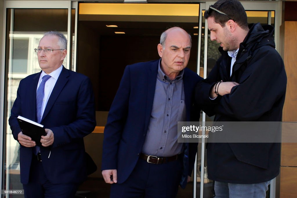 President of the Hellenic Football Federation Vangelis Grammenos (C) speaks to associates at the Federation's premises on March 14, 2018 in Athens, Greece. FIFA and UEFA urged the Hellenic Football Federation to adopt strict measures after the incident involving Ivan Savvidis, the owner of the Greek soccer team PAOK storming the field while armed with a holstered handgun at the end of the Greek Super League match on Sunday against AEK Athens.