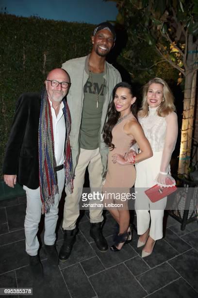 President of the Hollywood Foreign Press Association Lorenzo Soria NBA player Chris Bosh Adrienne Williams Bosh and Lilla Soria attend DuJour's...