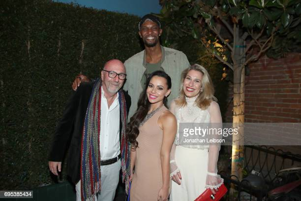 President of the Hollywood Foreign Press Association Lorenzo Soria NBA player Chris Bosh Adrienne Williams Bosh and Lilla Soria attend DuJour's...