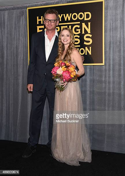 President of the Hollywood Foreign Press Association Theo Kingma and Miss Golden Globe 2015 Greer Grammar attend HFPA and InStyle celebrate the 2015...