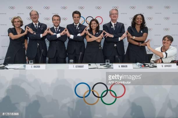 President of the Ile de France Region Valerie Pecresse French National Olympic Committee President Denis Masseglia French President Emmanuel Macron...