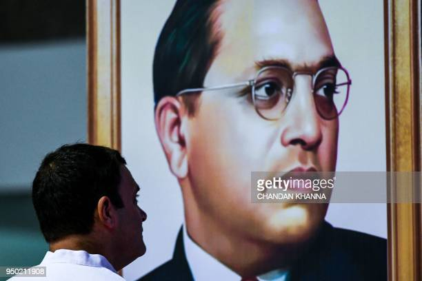 President of the Indian National Congress Party Rahul Gandhi pays tribute to Indian social reformer BR Ambedkar during the launch of the nationwide...