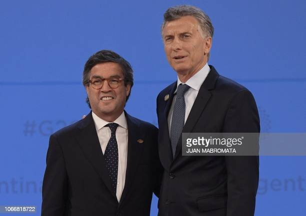 President of the InterAmerican Development Bank Luis Alberto Moreno is welcomed by Argentina's President Mauricio Macri at Costa Salguero in Buenos...