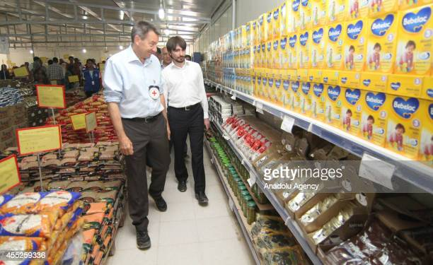 President of the International Committee of the Red Cross Peter Maurer and General Manager of the Turkish Red Crescent Mehmet Gulluoglu check the...
