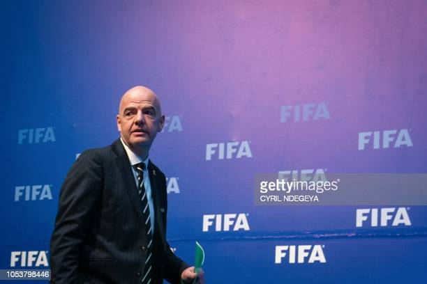 President of the International Federation of Association Football Gianni Infantino arrives for a press conference on October 26 after a FIFA Council...
