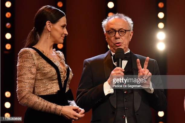 "President of the International Jury Juliette Binoche and Festival Director Dieter Kosslick are seen on stage at the opening ceremony and ""The..."