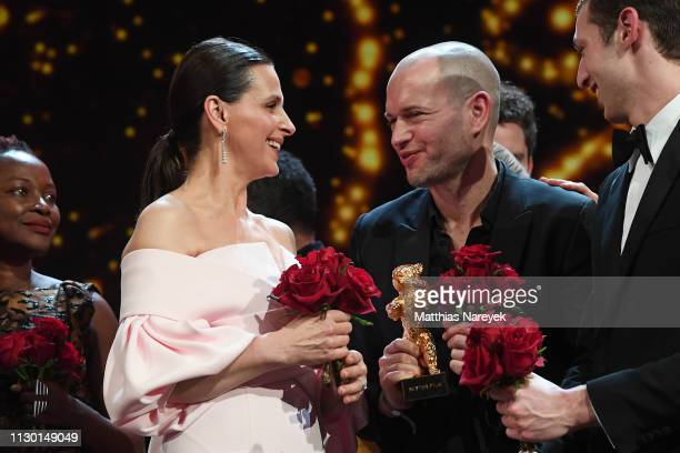 President of the International Jury Juliette Binoche and Nadav Lapid winner of the Golden Bear for Best Film for Synonymes are seen on stage at the...