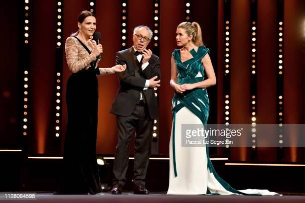 President of the International Jury Juliette Binoche Festival director Dieter Kosslick and Host Anke Engelke are seen on stage at the opening...