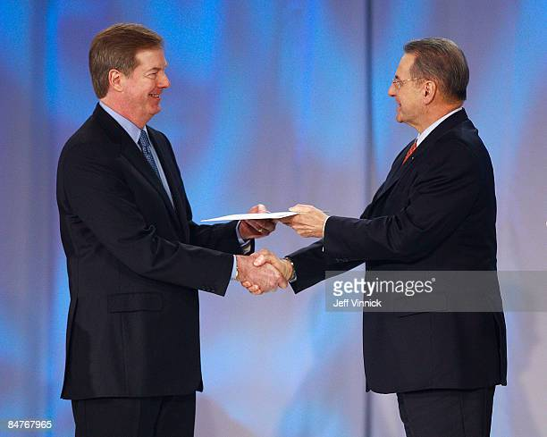 President of the International Olympic Committee Jacques Rogge presents USOC Chairman Larry Probst with an invitation to the 21st Winter Olympic...