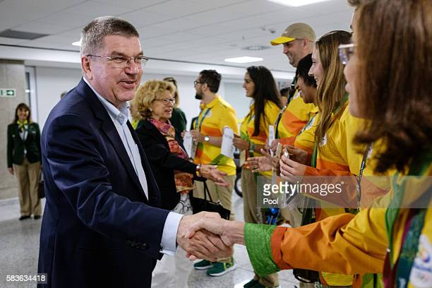 President of the International Olympic Committee Thomas Bach and his wife Claudia are welcomed by volunteers on his arrival for Rio 2016 Olympic...