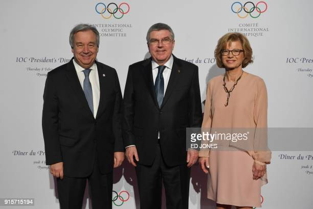 President of the International Olympic Committee Thomas Bach and his wife Claudia Bach stands with UN Secretary General Antonio Guterres on the red...