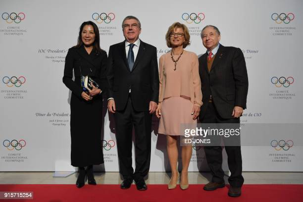 President of the International Olympic Committee Thomas Bach and his wife Claudia Bach stands with Malaysian actress Michelle Yeoh and her husband...