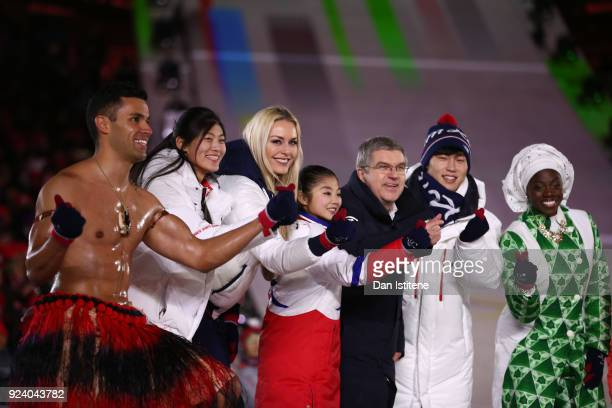 President of the International Olympic Committee Thomas Bach and Lee Heebeom President CEO of PyeongChang Organizing Committee stand on the stage...