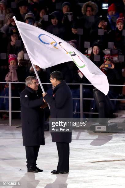 President of the International Olympic Committee Thomas Bach and Mayor of Beijing Chen Jining participate in the Olympic flag handover ceremony...