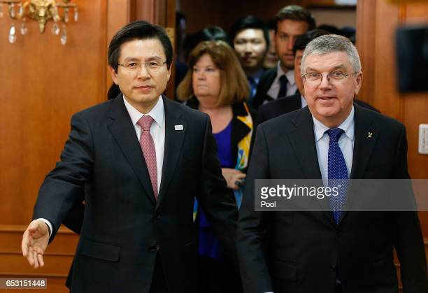 President of the International Olympic Committee Thomas Bach enters a room for a meeting with South Korea's Prime Minister and acting President Hwang...