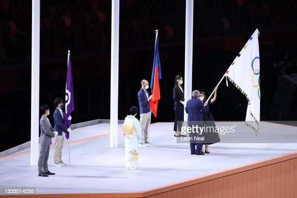President of the International Olympic Committee, Thomas Bach hands over the Olymmpic flag to Mayor of Paris, Anne Hidalgo during the Closing...