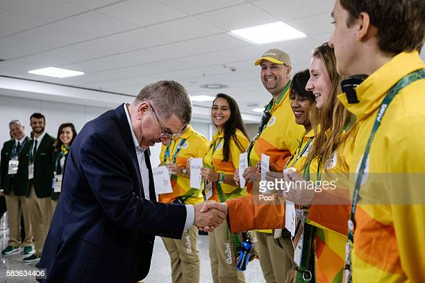 President of the International Olympic Committee Thomas Bach is welcomed by volunteers on his arrival for Rio 2016 Olympic games at Antonio Carlos...