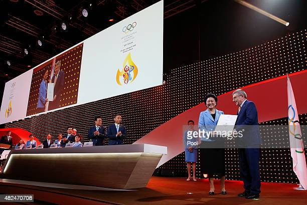 President of the International Olympic Committee Thomas Bach presents an Olympic diploma of appreciation to China's Vice Premier Liu Yandong second...