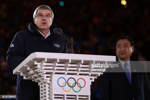 President of the International Olympic Committee Thomas Bach speaks as Lee Heebeom President CEO of PyeongChang Organizing Committee looks on during...