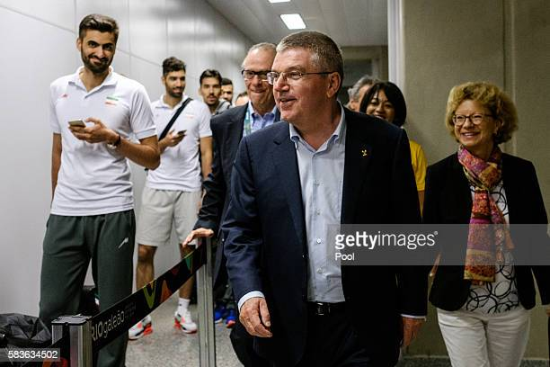 President of the International Olympic Committee Tomas Bach and his wife Claudia carry walk beside Iranian athletes on their arrival for Rio 2016...