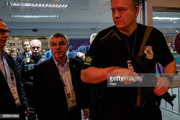 President of the International Olympic Committee Tomas Bach is escorted by a Brazilian Police officer on his arrival for Rio 2016 Olympic Games at...