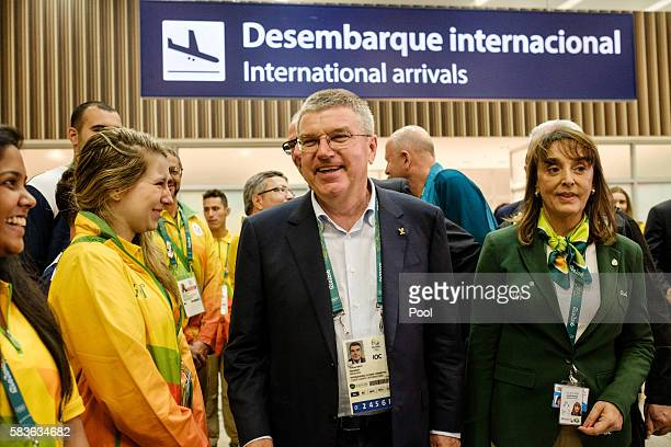 President of the International Olympic Committee Tomas Bach is welcomed by volunteers on his arrival for Rio 2016 Olympic Games at Antonio Carlos...