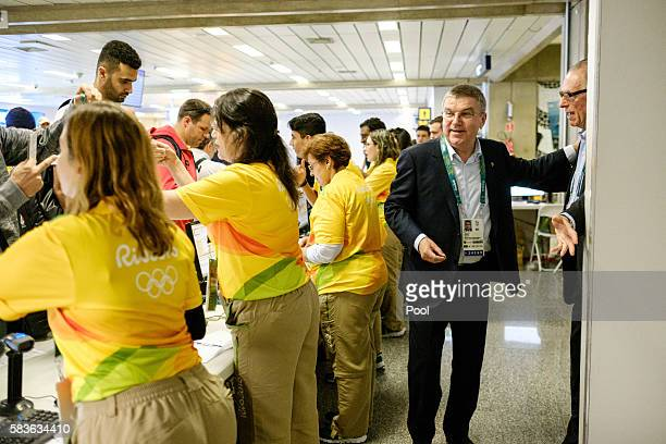 President of the International Olympic Committee Tomas Bach is seen at the credential counter on his arrival for Rio 2016 Olympic games at Antonio...