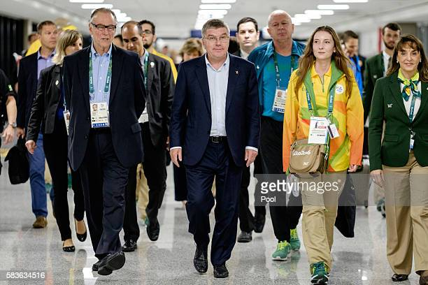 President of the International Olympic Committee Tomas Bach walks with Carlos Nuzman President of the Brazilian Olympic Committee on his arrival for...