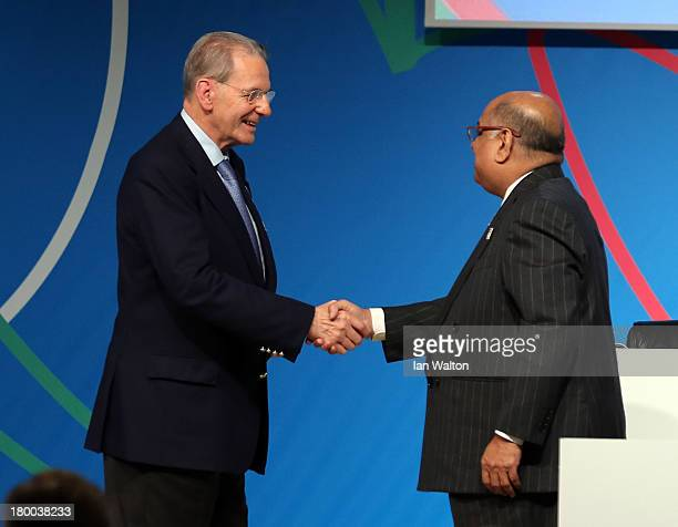President of the IOC Jacques Rogge shakes hands with WSF President N Ramachandran after a World Squash Federation presentation during the 125th IOC...