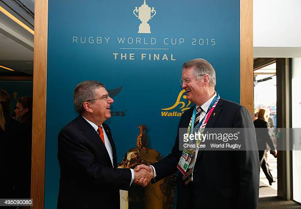 President of the IOC Thomas Bach shakes hands with the Chairman of the World Rugby Bernard Lapasset prior to the 2015 Rugby World Cup Final match...