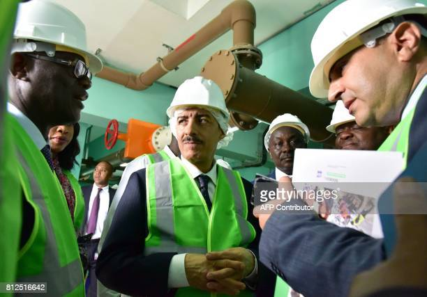 President of the Islamic Development Bank , Bandar Al Hajjar looks on as he visits a water tower in the Yopougon suburbs of Abidjan on July 11 during...