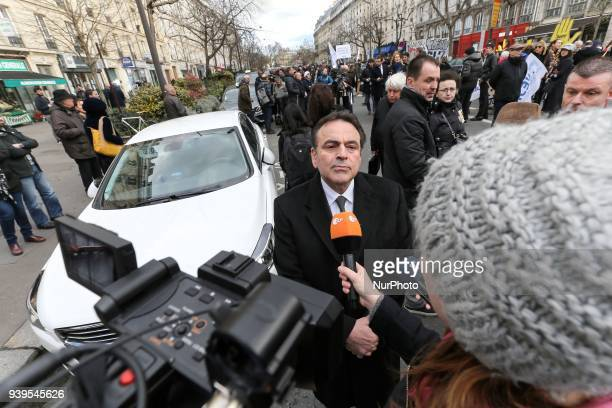 President of the Israelite Central Consistory of France Joel Mergui talks to media during a silent march in Paris on March 28 in memory of Mireille...