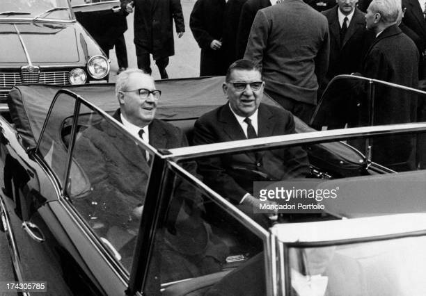 President of the Italian Republic Giuseppe Saragat sitting on board a car beside the Knight of Merit for Labour and President of the factory Giovanni...